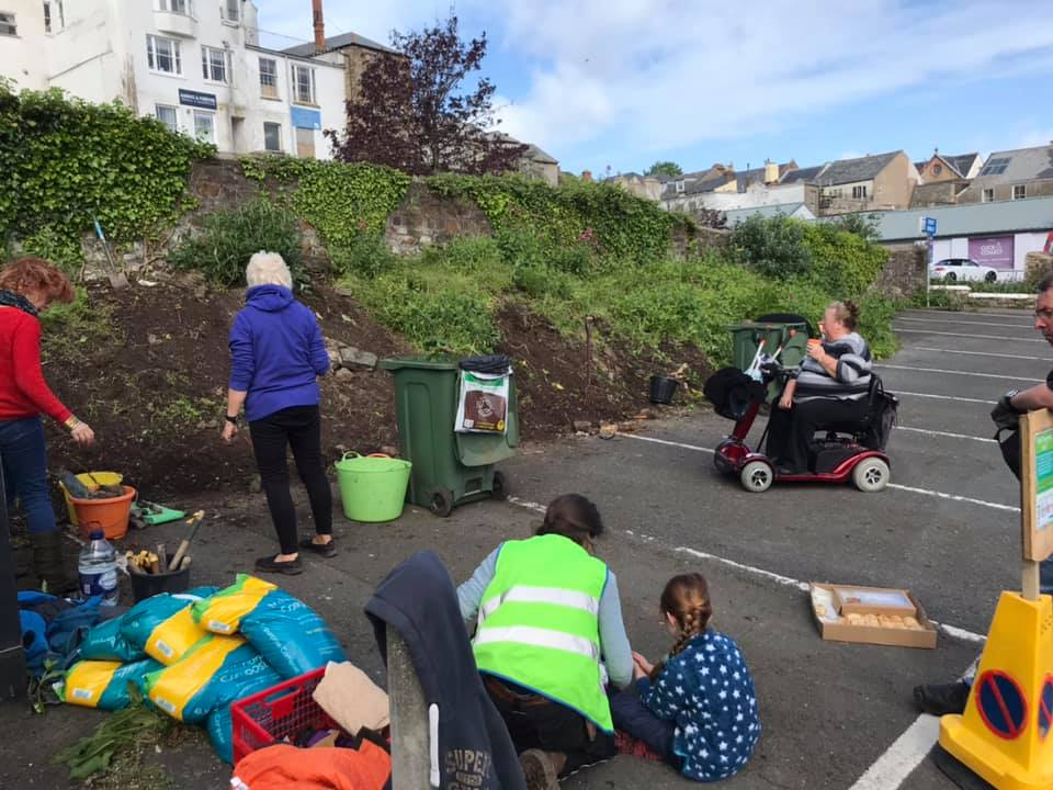 An image of a community working together in a car park