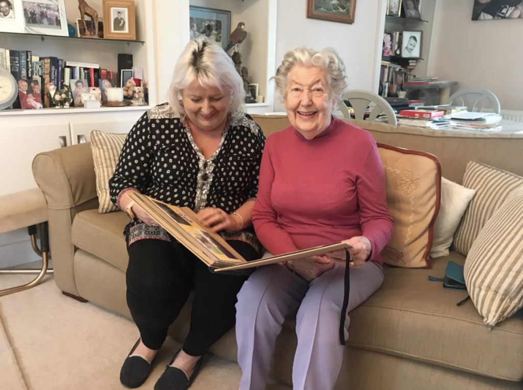 An elderly woman with dementia sits with a trained member of Rotherfield St Martin (RSM)