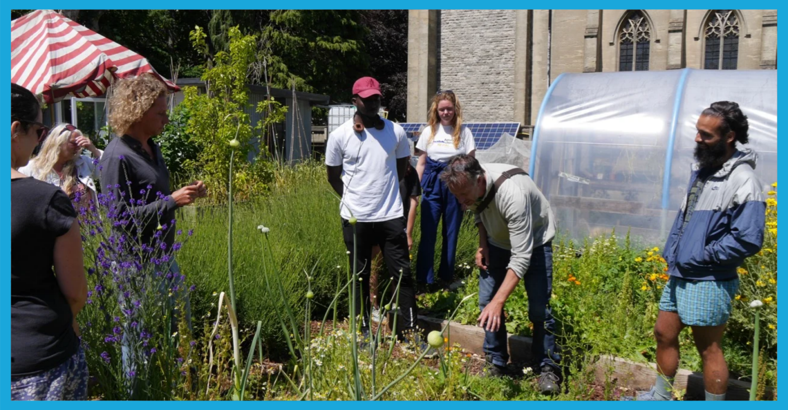The team at Grounded Community standing in a sunny garden